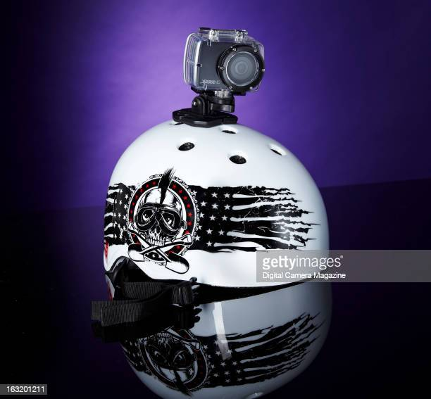 A Delkin Devices WingmanHD action camera on a crash helmet photographed on a purple background taken on July 18 2012