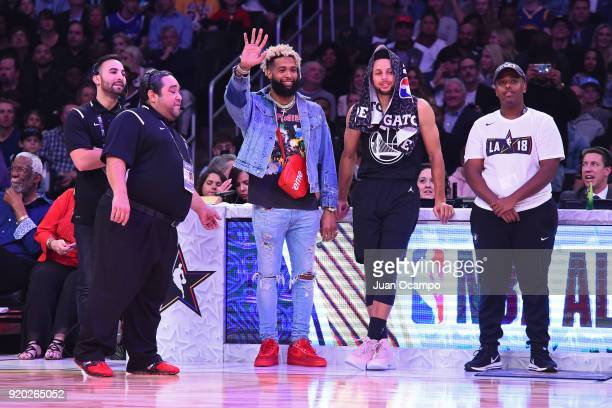 O'dell Beckham Jr and Stephen Curry of Team Stephen look on during the NBA AllStar Game as a part of 2018 NBA AllStar Weekend at STAPLES Center on...