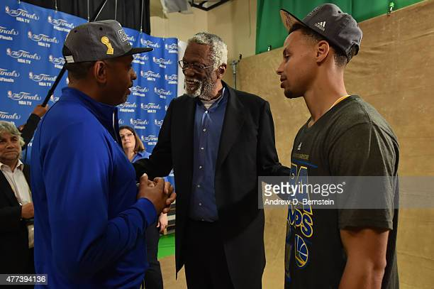 Dell Curry Bill Russell and Stephen Curry of the Golden State Warriors converse after Game Six of the 2015 NBA Finals at The Quicken Loans Arena on...