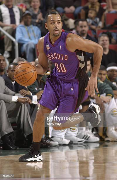 Dell Curry of the Toronto Raptors drives upcourt during the game against the Seattle SuperSonics at the Key Arena in Seattle Washington on December...