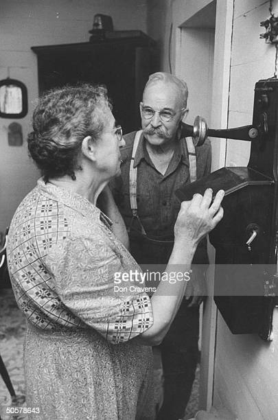 Della and Silas Underwood using the telephone