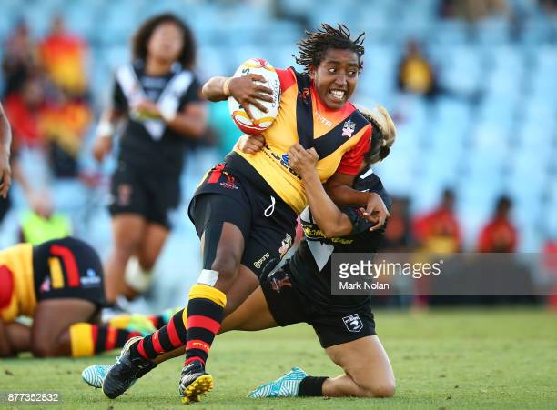 Della Audama of the Orchids runs the ball during the Women's Rugby League World Cup match between the Kiwi Ferns and the Papua New Guinea Orchids at...