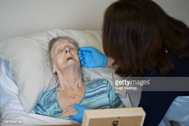Della Lilley visits and holds her mother, 89-year old Betty Whiteman, for the first time in two months after successfully passing a rapid Covid-19...
