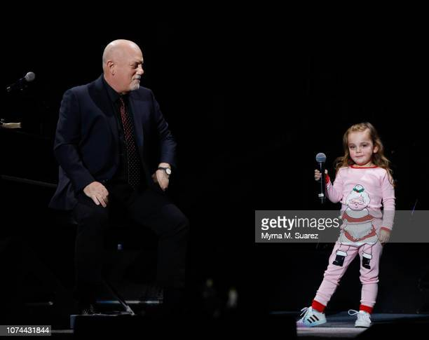 """Della Rose Joel, age 3, joins her father Billy Joel onstage for a duet of Della's favorite song """"Don't Ask Me Why"""" during Billy Joel's sold out show..."""