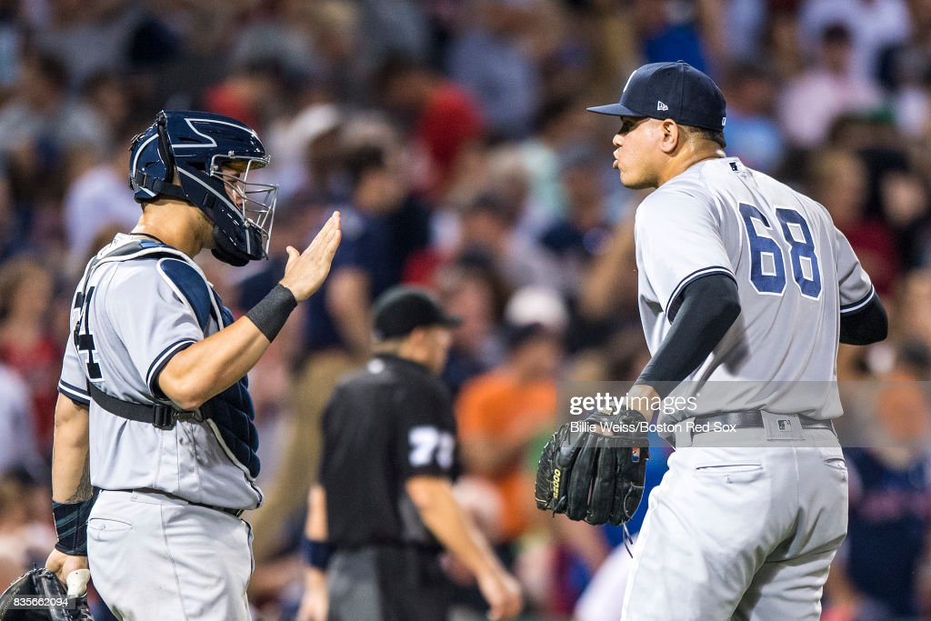 Dellin Betances #68 and Gary Sanchez #24 of the New York Yankees celebrate a victory against the New York Yankees on August 19, 2017 at Fenway Park in Boston, Massachusetts.