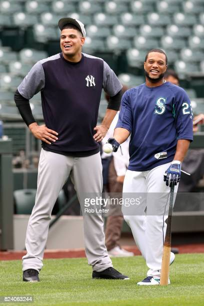 Dellin Betances of the New York Yankees and Robinson Cano talk before the game against the Seattle Mariners at Safeco Field on July 21 2017 in...