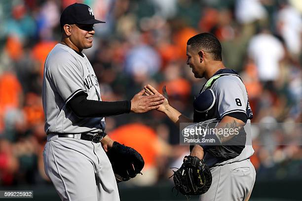 Dellin Betances of the New York Yankees celebrates with catcher Gary Sanchez after defeating the Baltimore Orioles at Oriole Park at Camden Yards on...
