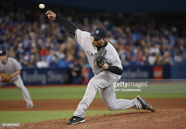 Dellin Betances of the New York Yankees delivers a pitch in the ninth inning during MLB game action against the Toronto Blue Jays on September 26...