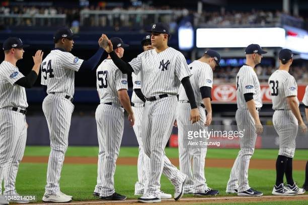 Dellin Betances of the New York Yankees highfives Aroldis Chapman during player introductions before the American League Wild Card game against the...