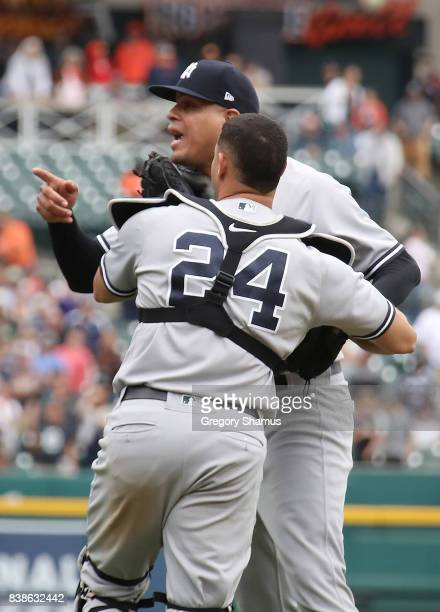 Dellin Betances of the New York Yankees is held back by Gary Sanchez as benches clear when he hit James McCann of the Detroit Tigers in the head...