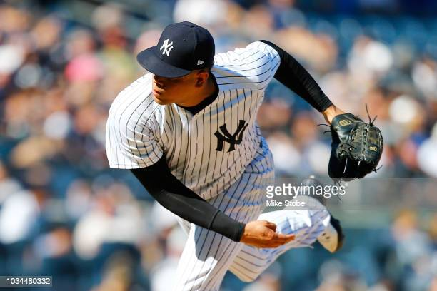 Dellin Betances of the New York Yankees pitches in the eighth inning against the Toronto Blue Jays at Yankee Stadium on September 16 2018 in the...