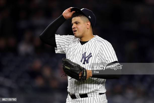 Dellin Betances of the New York Yankees reacts as he is pulled from the game after walking the first two batters of the ninth inning against the...