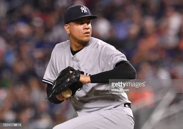 Dellin Betances of the New York Yankees throwing a pitch in the eighth inning against the Miami Marlins at Marlins Park on August 21 2018 in Miami...