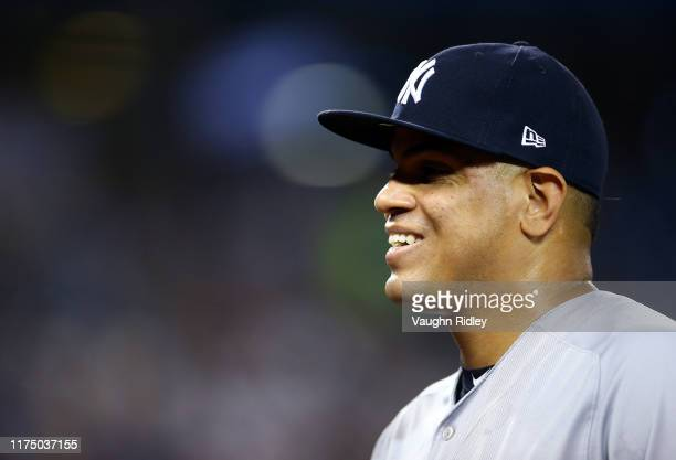 Dellin Betances of the New York Yankees walks back to the dugout in the fourth inning during a MLB game against the Toronto Blue Jays at Rogers...