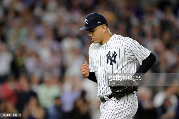 Dellin Betances of the New York Yankees walks back to the dugout after closing out the fifth inning against the Oakland Athletics in the American...