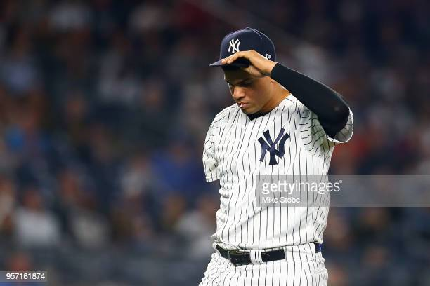 Dellin Betances of the New York Yankees walks off the mound after the third out of the top of the eighth inning against the Boston Red Sox at Yankee...