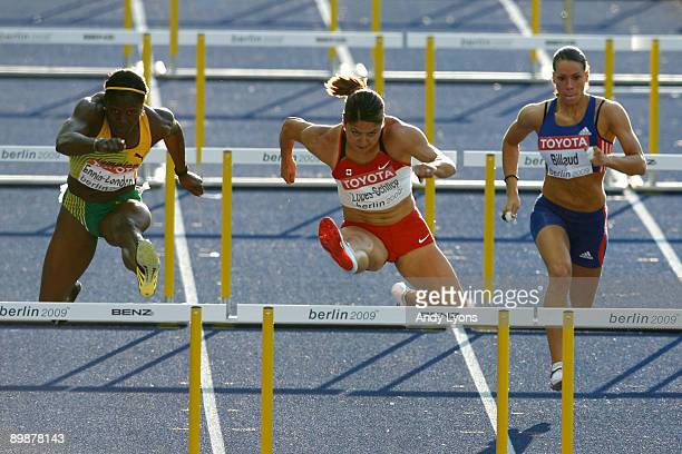 Delloreen EnnisLondon of Jamaica Priscilla LopesSchliep of Canada and Cindy Billaud of France compete in the women's 100 Metres Hurdles SemiFinal...