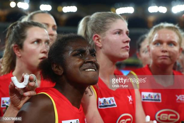 Delma Gisu and the Suns huddle during the AFLW Winter Series match between the Gold Coast Suns and the Brisbane Lions at Metricon Stadium on July 14...