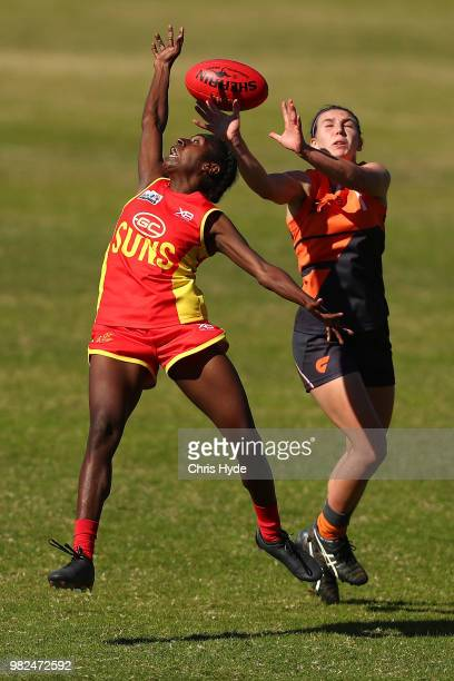 Delma Gisu of the Suns and Gabrielle Goldsworthy of the Giants compete for the ball during the round two AFLW Winter Series match between the Gold...