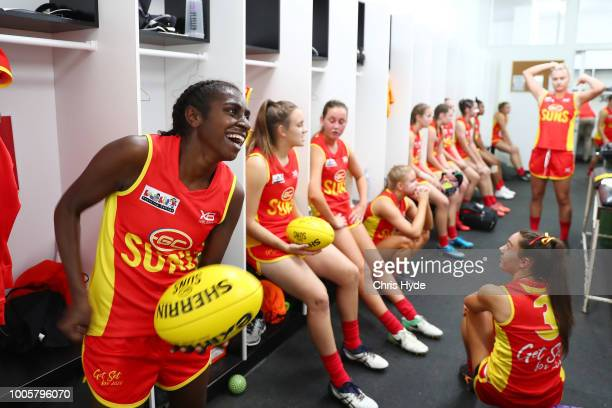 Delma Gisu of the Suns warms up before the round two AFLW Winter Series match between the Gold Coast Suns and the Southern Giants at Southport on...