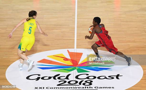 Delma Zita of Mozambique looks to get past Tessa Lavey of Australia during the womenÕs Pool A Basketball match between Australia and Mozambique on...