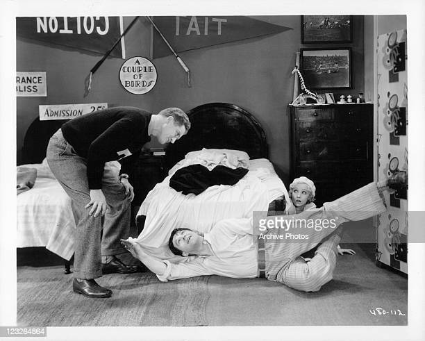 Delmer Daves and Gus Shy clown around while Bessie Love hides beside the bed in a scene from the film 'Good Girls Go To Paris' 1930