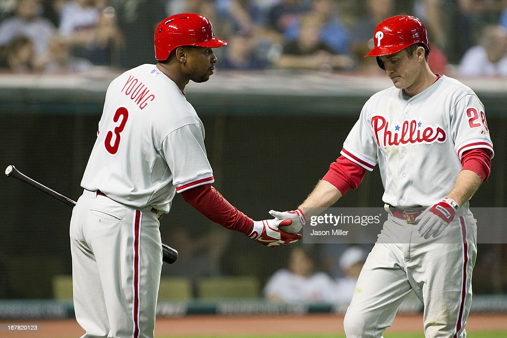 Delmon Young #3 celebrates with Chase Utley #26 of the Philadelphia Phillies after Utley hit a solo home run during the sixth inning against the Cleveland Indians at Progressive Field on April 30, 2013 in Cleveland, Ohio.