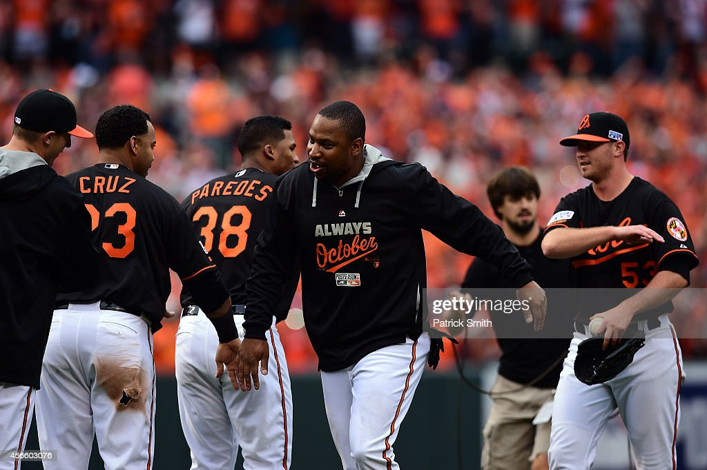 Delmon Young #27 of the Baltimore Orioles celebrates with teammate Nelson Cruz #23 after defeating the Detroit Tigers 7 - 6 in Game Two of the American League Division Series at Oriole Park at Camden Yards on October 3, 2014 in Baltimore, Maryland.