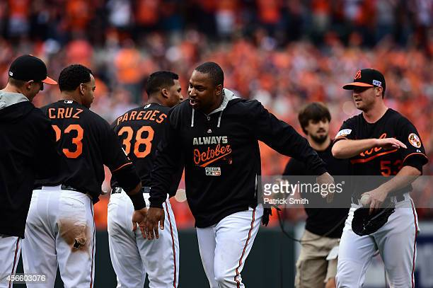 Delmon Young of the Baltimore Orioles celebrates with teammate Nelson Cruz after defeating the Detroit Tigers 7 6 in Game Two of the American League...