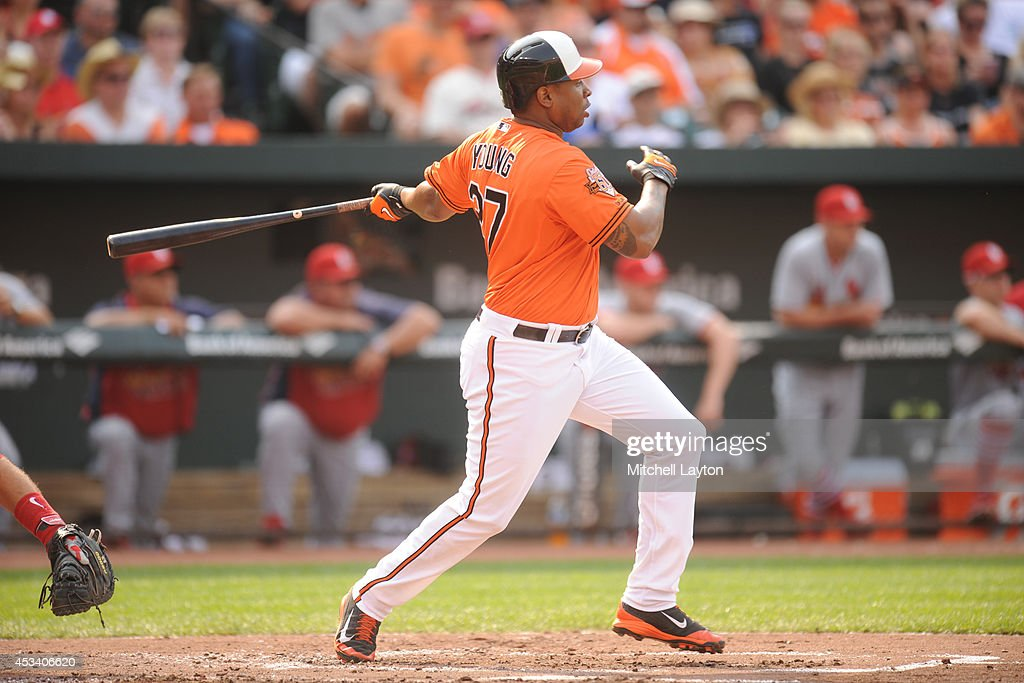 Delmon Young #27 of the Baltimore Orioles doubles in the second inning to score J.J. Hardy #2 (not pictured) during a baseball game against the St. Louis Cardinals on August 9, 2014 at Oriole Park at Camden Yards in Baltimore, Maryland. The Orioles won 10-3.