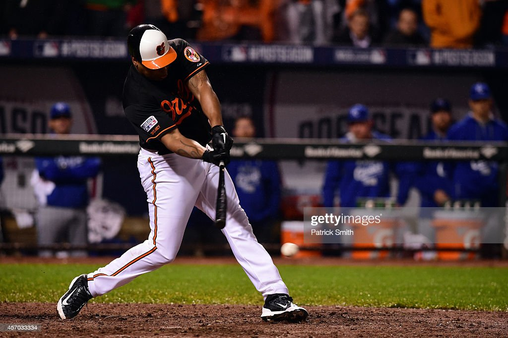 Delmon Young #27 of the Baltimore Orioles hits a single to center field in the tenth inning against Greg Holland #56 of the Kansas City Royals during Game One of the American League Championship Series at Oriole Park at Camden Yards on October 10, 2014 in Baltimore, Maryland.
