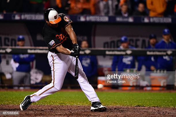 Delmon Young of the Baltimore Orioles hits a single to center field in the tenth inning against Greg Holland of the Kansas City Royals during Game...
