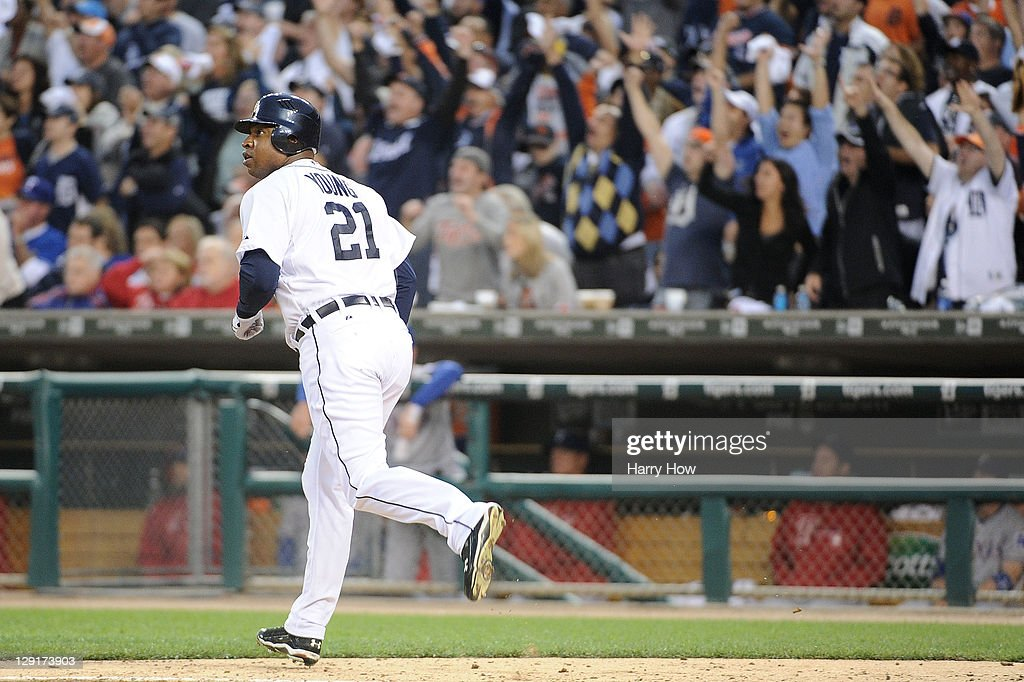 Delmon Young #21 of the Detroit Tigers watches his two-run home run in the sixth inning of Game Five of the American League Championship Series against the Texas Rangers at Comerica Park on October 13, 2011 in Detroit, Michigan.
