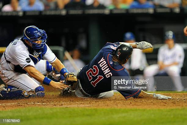 Delmon Young of the Minnesota Twins slides in ahead of the tag of Matt Treanor of the Kansas City Royals at Kauffman Stadium on June 2 2011 in Kansas...