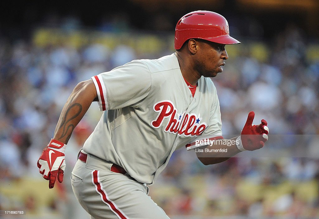 Delmon Young #3 of the Philadelphia Phillies runs to first base after hitting a single in the second inning against the Los Angeles Dodgers at Dodger Stadium on June 27, 2013 in Los Angeles, California.