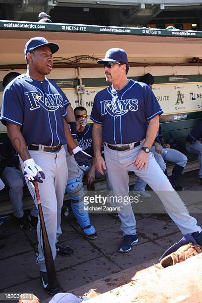 Delmon Young of the Tampa Bay Rays talks with Hitting Coach Derek Shelton in the dugout during the game against the Oakland Athletics at Oco Coliseum...
