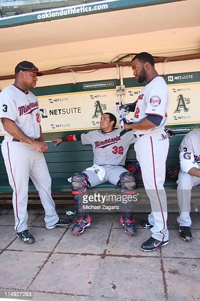 Delmon Young Rene Rivera and Denard Span of the Minnesota Twins hang out in the dugout before the game against the Oakland Athletics at the...