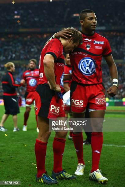 Delon Armitage consoles his captain Jonny Wilkinson of Toulon after their defeat during the Top 14 Final match between Castres Olympique and Toulon...