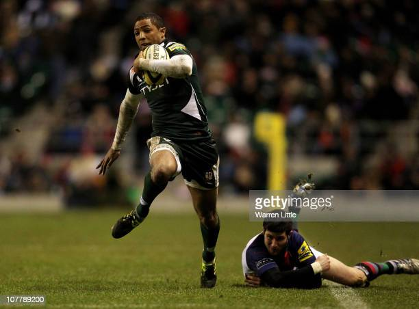 Delon Armitage of London Irish evades a tackle from Tom Casson of Harlequins during the AVIVA Premiership match between Harelquins and London Irish...