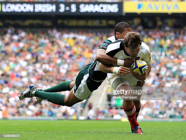 Delon Armitage of London Irish fails to stop Schalk Brits of Saracens scoring a try during the Aviva Premiership Rugby Union match between London...
