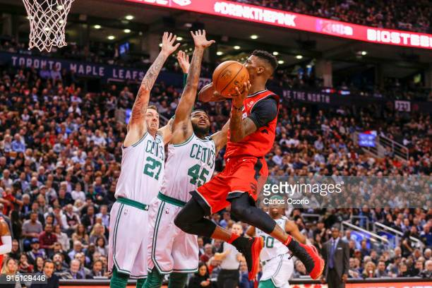 TORONTO ON FEBRUARY 6 Delon Wright of the Raptors drives to the net while being guarded by Daniel Theis and Kadeem Allen of the Celtics during the...