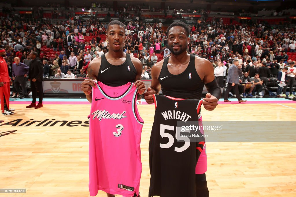 huge selection of 2abc2 a0f2e Delon Wright of the Toronto Raptors and Dwyane Wade of the ...