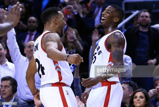 Delon Wright of the Toronto Raptors celebrates with Norman Powell after sinking a buzzer beater to end the 3rd quarter of an NBA game against the...