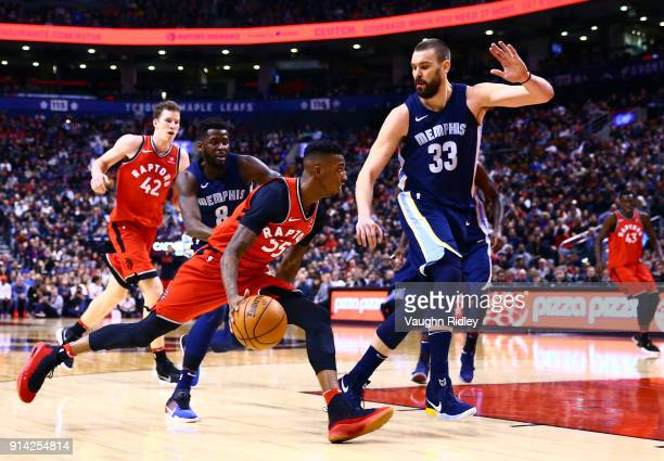 Delon Wright of the Toronto Raptors dribbles the ball as Marc Gasol of the Memphis Grizzlies defends during the second half of an NBA game at Air...