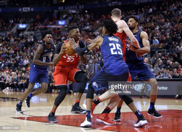 Delon Wright of the Toronto Raptors dribbles the ball as Wes Iwundu of the Orlando Magic defends during the second half of an NBA game at Air Canada...