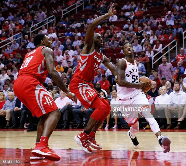 Delon Wright of the Toronto Raptors drives past Luc Mbah a Moute of the Houston Rockets and Tarik Black to the basket at Toyota Center on November 14...