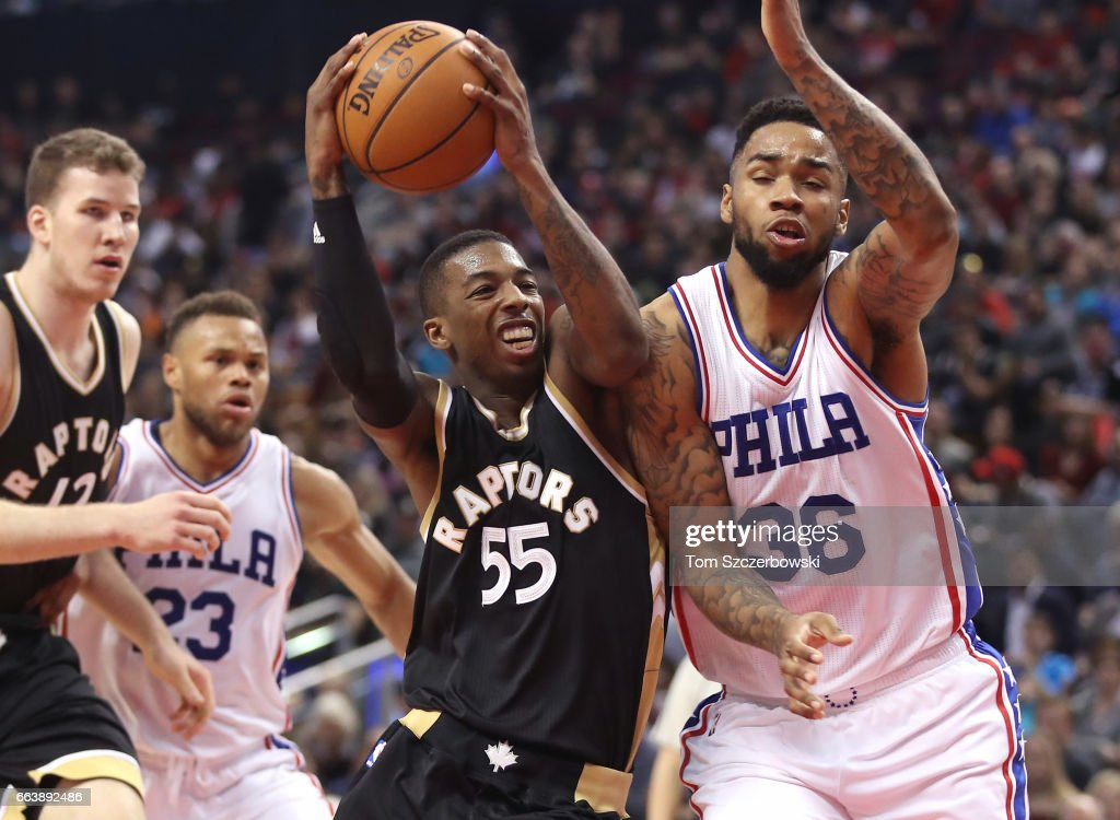 Delon Wright #55 of the Toronto Raptors goes to the basket against Shawn Long #36 of the Philadelphia 76ers during NBA game action at Air Canada Centre on April 2, 2017 in Toronto, Canada.