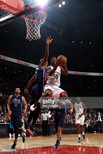 Delon Wright of the Toronto Raptors goes to the basket against the Dallas Mavericks on December 22 2015 at the Air Canada Centre in Toronto Ontario...