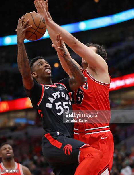 Delon Wright of the Toronto Raptors goes up against Paul Zipser of the Chicago Bulls at the United Center on February 14 2018 in Chicago Illinois...