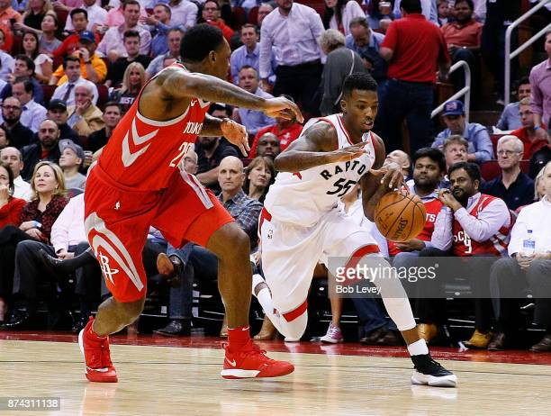 Delon Wright of the Toronto Raptors looks to drive baseline on Tarik Black of the Houston Rockets at Toyota Center on November 14 2017 in Houston...